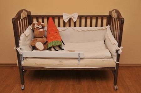Деревянный борт для детской кровати